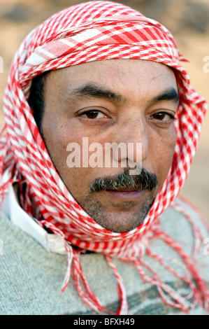 A closeup facial portrait of a middle age Middle Eastern, Egyptian Arab Bedouin man, living in Dakhla Oasis, in - Stock Photo