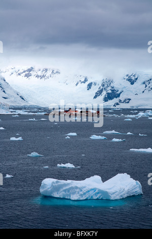 Iceberg floating in front of the Chilean Base Station 'Gonzalez Videla' near Paradise Bay, Antarctica - Stock Photo