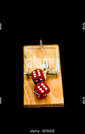 Dice on mousetrap - Stock Photo
