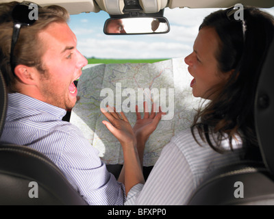 couple fighting in car - Stock Photo