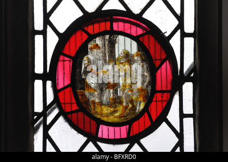 Medieval stained glass roundel in St. Michael`s Church, Begbroke, Oxfordshire, England, UK - Stock Photo