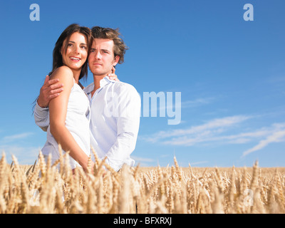 young couple in wheat field - Stock Photo