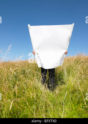 man with blueprints in field - Stock Photo