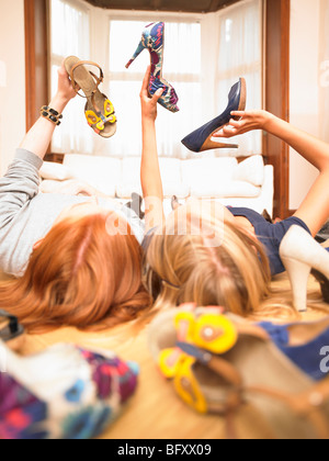 young women choosing shoes - Stock Photo