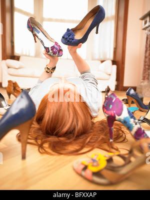 young woman choosing shoes - Stock Photo