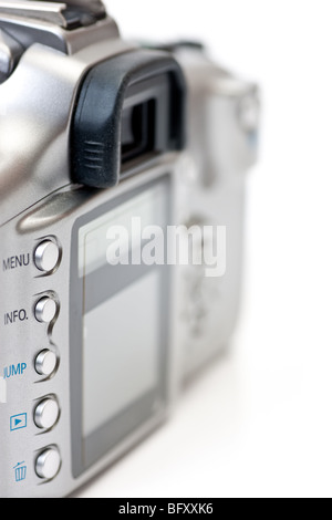 The back of a digital SLR camera, with focus on the buttons and LCD display, isolated on white. - Stock Photo