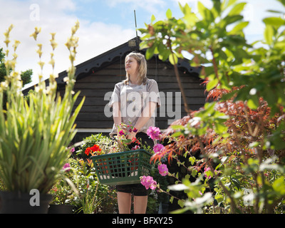Female Buying Plants At Garden Center - Stock Photo