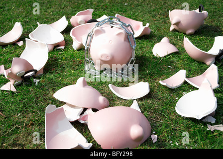 piggy bank in chains - Stock Photo