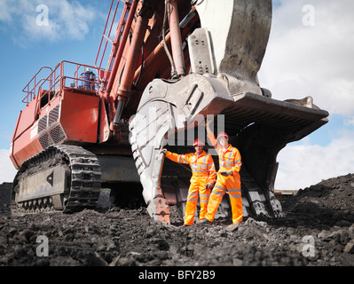 Coal Miners With Digger - Stock Photo