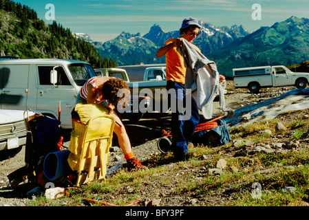 Coast Mountains, BC, British Columbia, Canada - Rock Climbers preparing to climb on Backcountry Mountain Climbing - Stock Photo