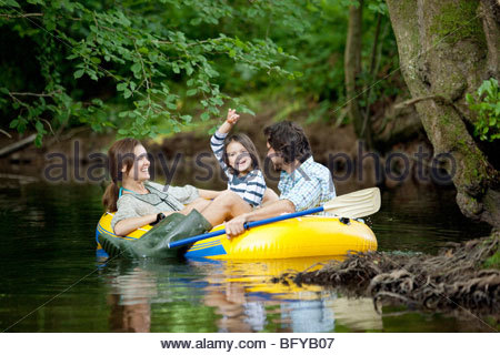 Young Girl On An Inflatable Raft In The Water Smiling