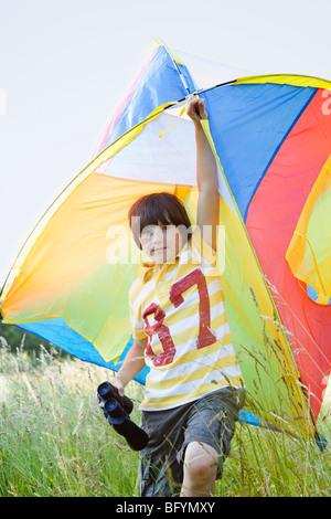 Boy With Kite and Binoculars - Stock Photo