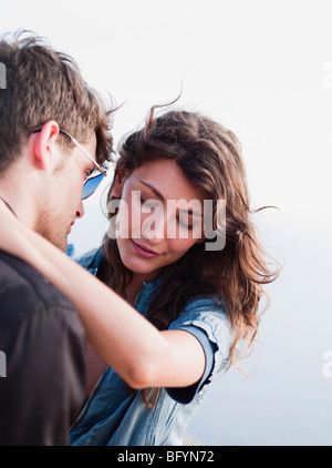 couple embracing each other at cliff - Stock Photo