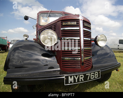 Wide angle shot of an maroon and black 1952 Bedford Scammell seen in 2009 at the Hollowell Steam Rally - Stock Photo