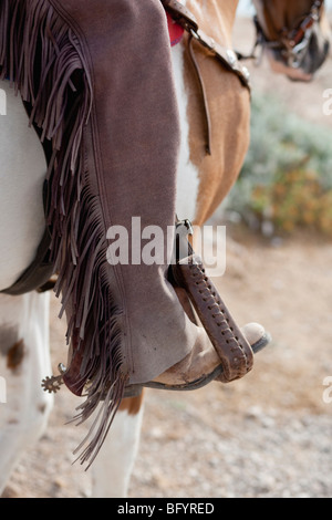 foot in stirrup - Stock Photo