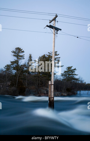Electricity pole submerged by flood - Stock Photo