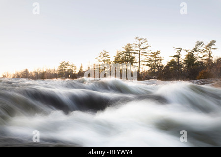 Fast flowing river - Stock Photo
