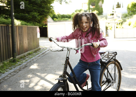 Smart girl alone at home - Stock Photo