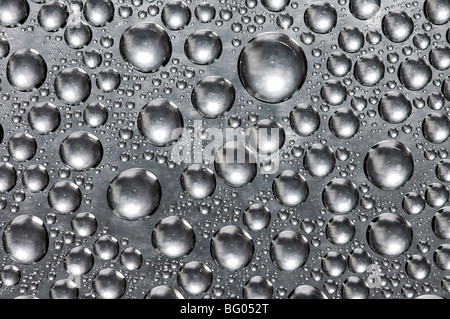 water drops on stainless steel surface - Stock Photo