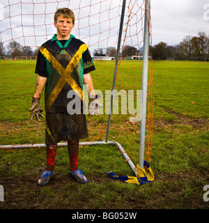 Two dirty teenagers standing in goal mouth after football/soccer  practice, Cambridge New Zealand - Stock Photo