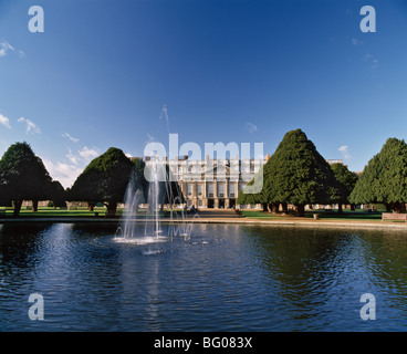 Lake, fountain and ornamental trees in Hampton Court Palace grounds, near London, England, United Kingdom, Europe - Stock Photo