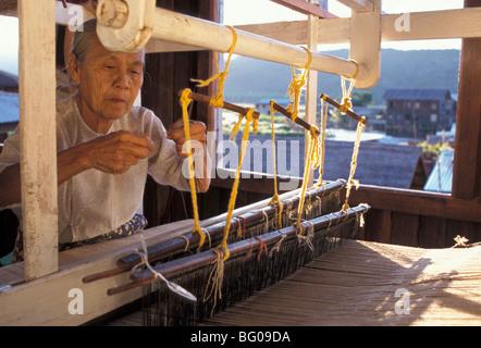 Weaver with her loom, Inle Lake, Shan State, Myanmar (Burma), Asia - Stock Photo