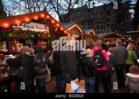 UK, England, Manchester, Albert Square, crowds of shoppers in Continental Christmas Market - Stock Photo