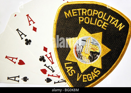 Four Aces cards and patch of the Las Vegas Metropolitan Police Department. - Stock Photo