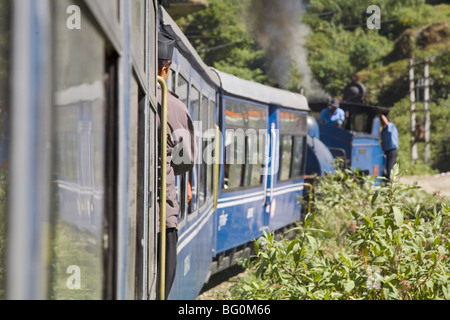 Steam train known as Toy Train of the Darjeeling Himalayan Railway, en route Darjeeling to Ghoom, Darjeeling, West - Stock Photo