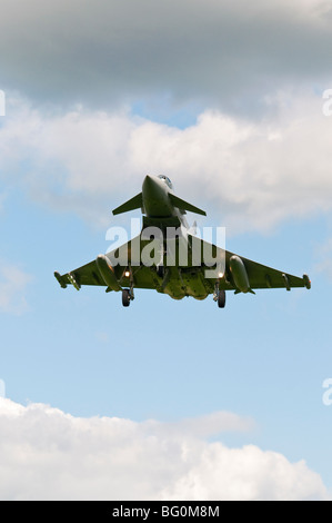 A Typhoon fighter on landing approach at RAF Coningsby in Lincolnshire. - Stock Photo