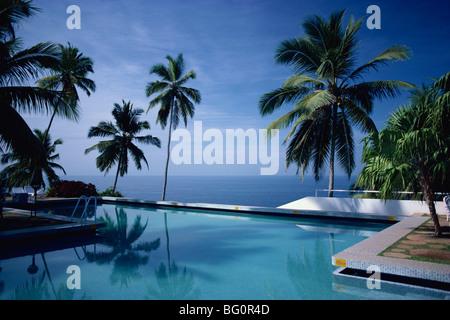 Hotel swimming pool, Kovalam, Kerala state, India, Asia - Stock Photo
