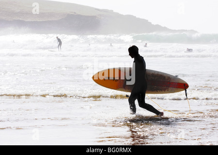Surfers in Cornwall - Stock Photo