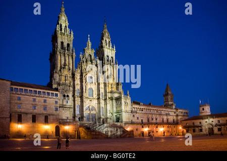 Facade of cathedral seen from Praza do Obradoiro floodlit at night, Santiago de Compostela, Galicia, Spain - Stock Photo