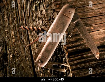 Rusty pocket knife - Stock Photo