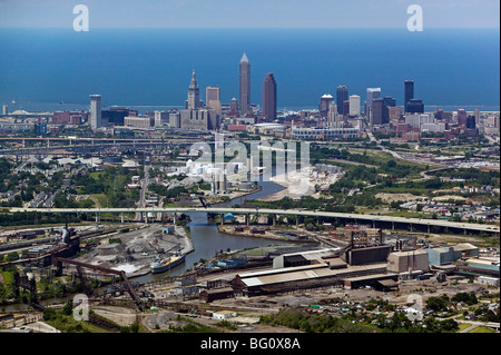 aerial view above Cleveland Ohio skyline industrial area steel mills Cuyahoga river Lake Erie - Stock Photo