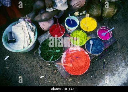 Children sell Tikka powder on the street in Madurai, India - Stock Photo