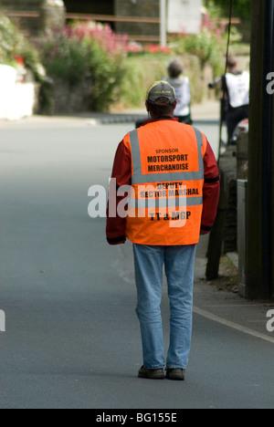 TT marshal on road, Isle of Man - Stock Photo