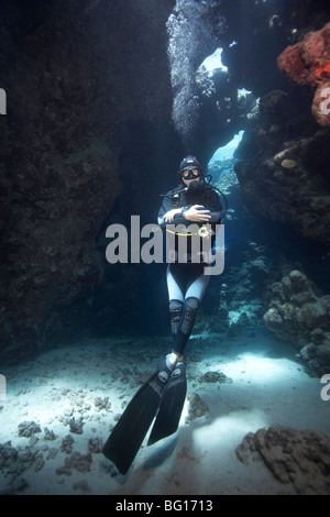 Diver in underwater cave - Stock Photo