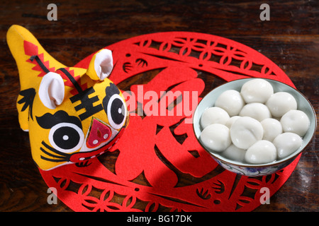 Close-up of Tangyuan and paper cut - Stock Photo