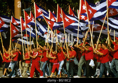 May Day marchers with Cuban flags, Plaza de la Revolucion, Havana, Cuba, West Indies, Central America - Stock Photo