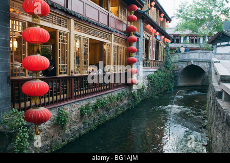 Traditional architecture of riverside restaurant in Lijiang Old Town, Lijiang, UNESCO, Yunnan Province, China, Asia - Stock Photo