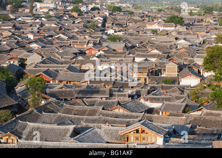 Crowded rooftops in Lijiang Old Town, UNESCO World Heritage Site, Yunnan Province, China, Asia - Stock Photo