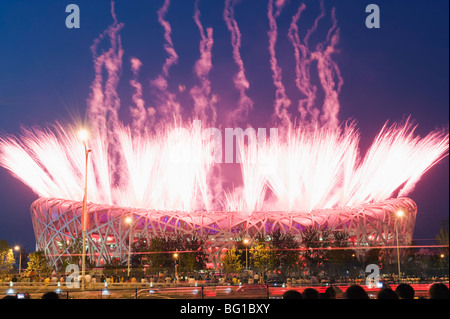 Fireworks on the Birds Nest National Stadium during the opening ceremony of the 2008 Olympic Games, Beijing, China, - Stock Photo