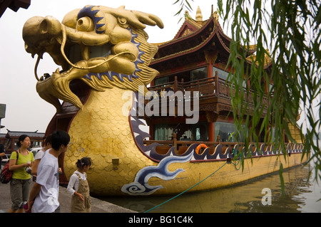 Hangzhou, China.  Cruise boat in the shape of a dragon on the West Lake. - Stock Photo