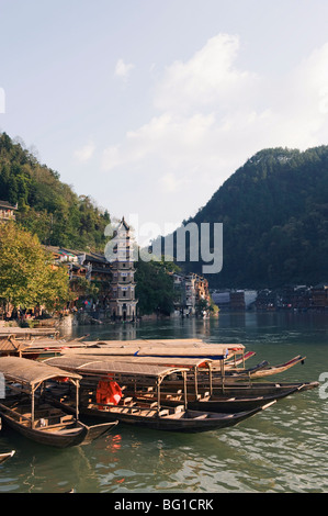 Boats tied up on a river in the old town of Fenghuang, Hunan Province, China, Asia - Stock Photo