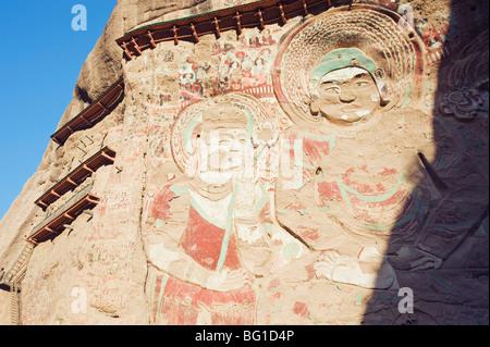 Sakyamuni rock sculptures at Lashao temple, Shuilian Dong Water Curtain Cave, Northern Wei dynasty, Gansu Province, - Stock Photo