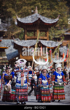 Elaborate costumes worn at a traditional Miao New Year festival in Xijiang, Guizhou Province, China, Asia - Stock Photo
