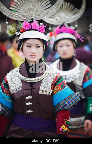 Women in ethnic costume at a Lunar New Year festival in the Miao village of Qingman, Guizhou Province, China, Asia - Stock Photo