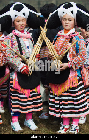 Long Horn Miao women at lunar New Year festival celebrations in Sugao ethnic village, Guizhou Province, China, Asia - Stock Photo