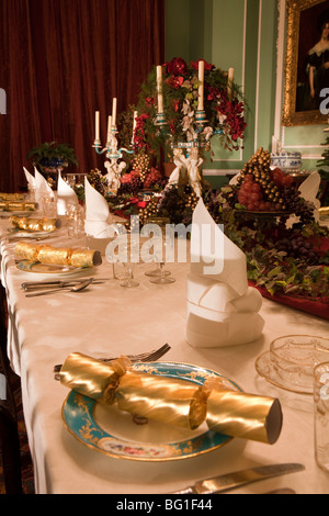 Christmas table set with baubles on a chandelier; UK, England, Cheshire,  Knutsford, Tatton Hall, Dining Room table set and